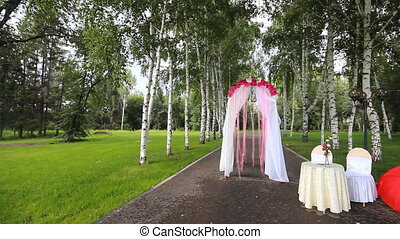 Wedding red archway - Wedding archway with flowers arranged...