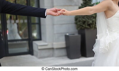 Wedding couple holding hands at wedding