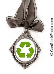 Cameo silver locket with green recycle symbol