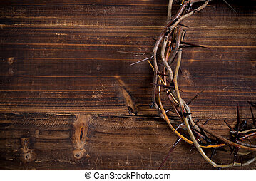 Crown of thorns on a wooden background - Easter