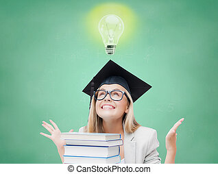 happy student girl in bachelor cap with books - education,...