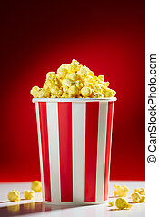 Bowl Filled With Popcorns For Movie Night - Red bowl full of...