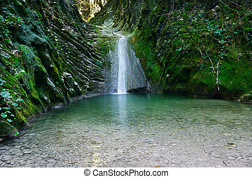 Marvellous waterfall on a mountain stream in forest
