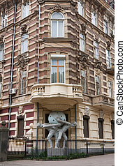 House with atlantes statue in historical area of Odessa