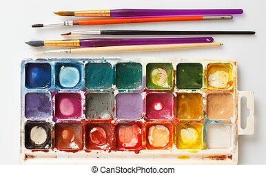 Box of paints and paint brushes - Closeup of water-color...