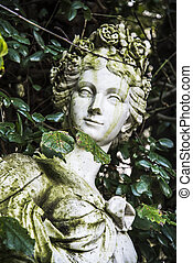 Statue - Old statue inside the Royal Palace garden in...