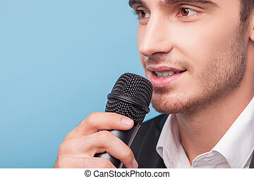 Cheerful young male reporter is telling news - Attractive...