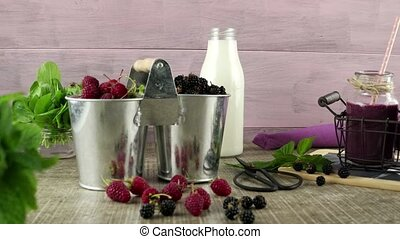 Fresh red fruits smoothie on vintage decorated wooden table....