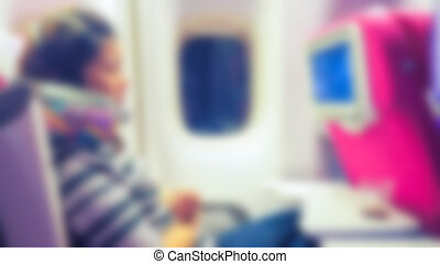 Abstract blur woman in the interior of the airplane