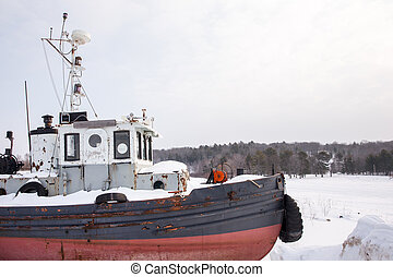 Old Tug Boat in Winter with Copy Space