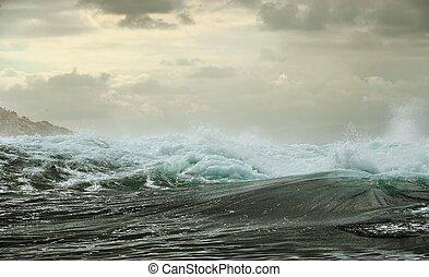 Ocean storm. Wave on the surface of the ocean. Wave breaks...