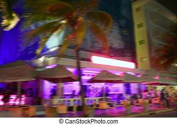 Blurred night colorful lights in Miami Beach - Blurred night...