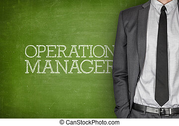 Operations manager on blackboard with businessman in a suit...