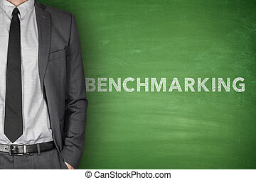 Benchmarking text on black blackboard - Benchmarking text on...