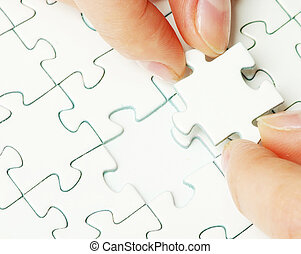 puzzle piece - hands holding a puzzle piece business...