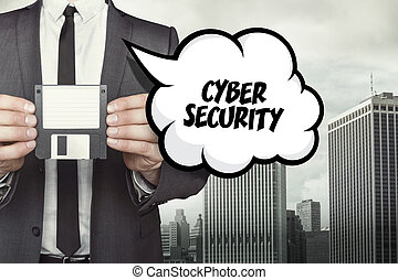 cyber security text on speech bubble with businessman...
