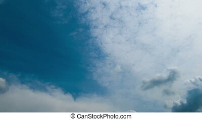 Clouds move across the blue sky - White, rain, gray, haze,...