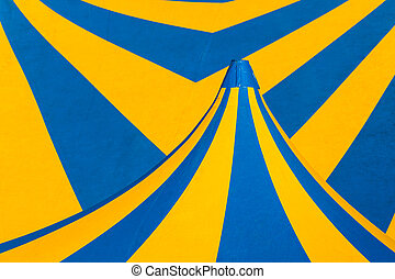 yellow and blue circus tent - closeup of yellow and blue...