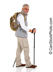 mid age man walking with trekking poles isolated on white