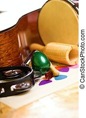 Green egg shaker among other instruments - Vertical photo of...