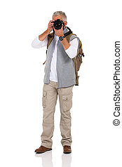 mature male tourist taking pictures with digital camera
