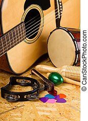 Set of musical instruments on OSB - Vertical photo with...