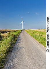 Road Leading To Wind Turbine - A country road leadings...