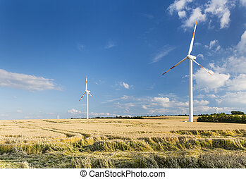 Wind Turbines And Fields - Wind turbines in golden fields in...