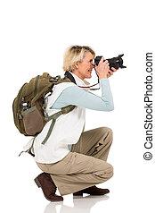 mid age female tourist taking pictures - happy mid age...