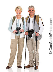mid age couple standing on white - full length portrait of...