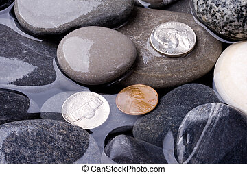 Sea water, stones and coins
