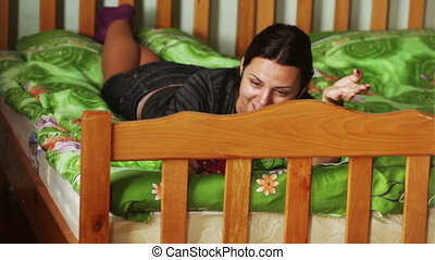 Girl talking on Skype - In room hostel on bed girl speaks on...