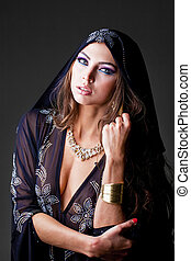 Portrait of the young sexy woman in black tunic Arabic -...