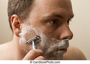 Man shaving his cheek