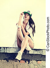 gumshoes - Modern girl wearing casual clothes and a cap...