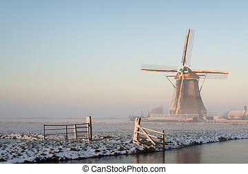 Winter landscape in the Netherlands with a windmill - Winter...