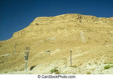 Israel desert with yellow stone mountains