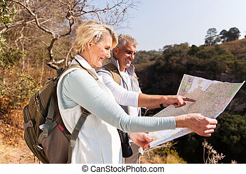 senior hikers on top the mountain - active senior hikers on...