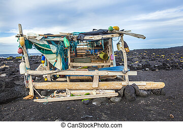 abandoned fishermans hut at the beach in Timanfaya national...