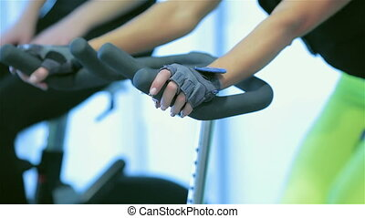 Close-up view of simulators stationary bike at the gym -...