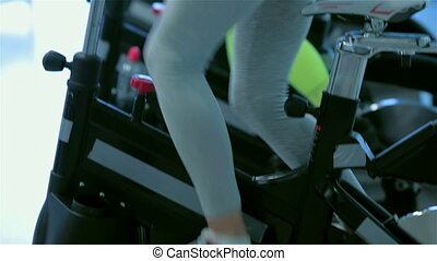 Athletic girl with sexual booty - Training on a bicycles....