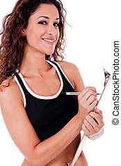 Fitness woman writing on a clip board