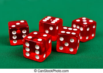 dice on green table - red dice on green table, close up