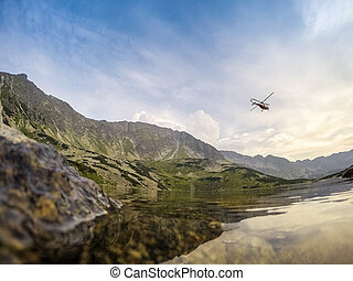 Rescue action in the mountains - Clean lake and helicopter...