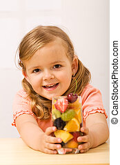 Happy little girl with fruity refreshment - healthy diet...