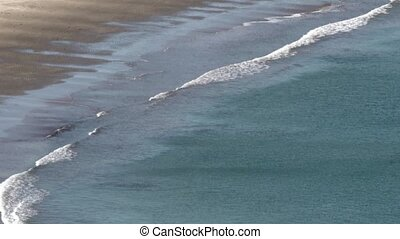 Aerial view seascape of waves breaking to shore