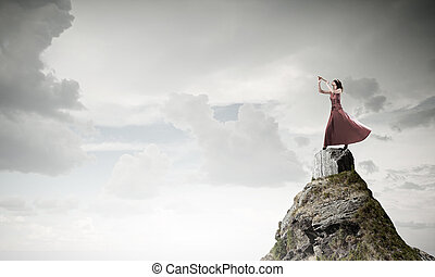 Woman play fife - Young woman in evening dress on rock...
