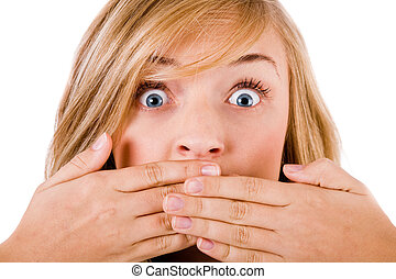 Closeup of young women covering her mouth with both hands