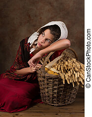 Victorian peasant girl with basket - Reenactment image of a...