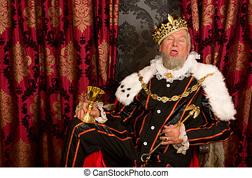Sleepy drunk king - Old funny king getting drunk holding a...